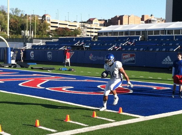 Injured KU running back Taylor Cox looked pretty healthy during Tuesday's drills. He is expected to play this weekend against Kansas State.
