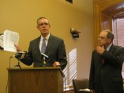 House Minority Leader Paul Davis, D-Lawrence, and state Senate Minority Leader Anthony Hensley, D-Topeka, speak Tuesday at a news conference. They said a revenue projection of Gov. Sam Brownback's tax cuts, if applied proportionately, would result in a $900 million cut to education. Brownback has said he will protect school funding.
