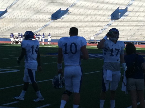 It was white (and not red) jerseys for the KU quarterbacks during Tuesday's practice at Memorial Stadium.