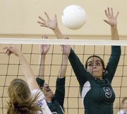 Bishop Seabury's Sarah McDermott (9) gets a block at the net during a match against Kansas City East Christian Academy at the Veritas volleyball triangular on Tuesday, October 2, 2012 in Eudora.