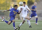 Free State midfielder A.J. Ware contests a ball with Olathe South midfielder Eddy Mortera during the first half on Tuesday, Oct. 2, 2012 at Free State High School.