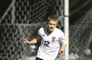 Lawrence High midfielder Johannes Reiber gestures after scoring a goal against Leavenworth during the first half on Tuesday, Oct. 2, 2012 at Lawrence High School.