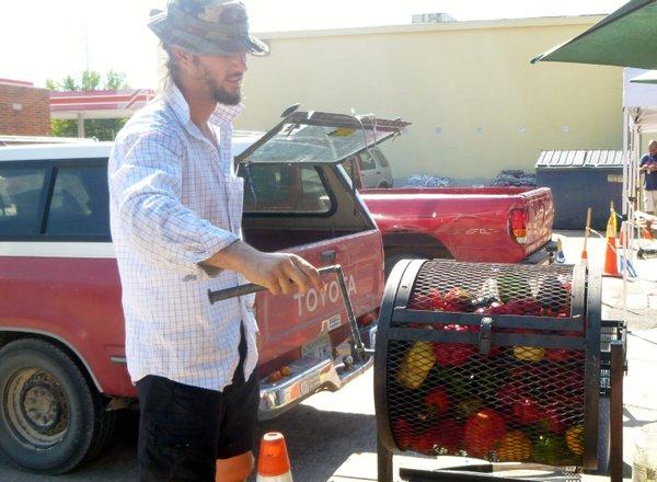 Avery Lominska roasting peppers at Cottin's Hardware Farmers Market.