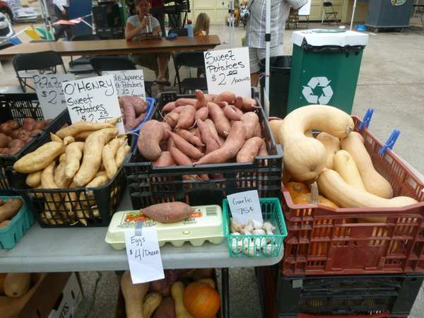 Winter squash, potatoes and peppers overflow Avery's Produce tables at Cottin's Hardware Farmers Market.