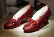 "In this April 10, 1996 file photo, the ruby slippers worn by Judy Garland in the 1939 film ""The Wizard of Oz"" are shown on display during a media tour of the ""America&squot;s Smithsonian"" exhibition in Kansas City, Mo. The ruby slippers are leaving the U.S. on their first international journey to London&squot;s Victoria and Albert Museum."