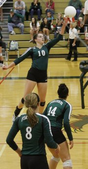 Free State senior Shelby Holmes tips a ball across the net during the Firebirds' triangular Thursday, Oct. 4, 2012, at FSHS.