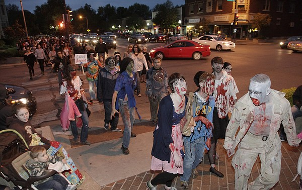 Participants in the 6th annual Lawrence Zombie Walk stumble along Mass. St. from South Park to downtown Thursday, October 4, 2012.
