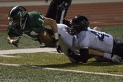 Free State receiver Tye Hughes falls forward into the end zone for a touchdown as Shawnee Mission East defensive back Mitchell Tyler brings him down during the Firebirds' homecoming game against the Lancers on Friday, Oct. 5, 2012, at FSHS.