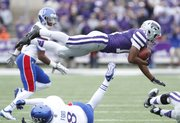 Kansas State kick returner Tyler Lockett gets taken off his feet by Kansas special teams player Josh Ford during the first quarter on Saturday, Oct. 6, 2012 at Bill Snyder Family Stadium in Manhattan.