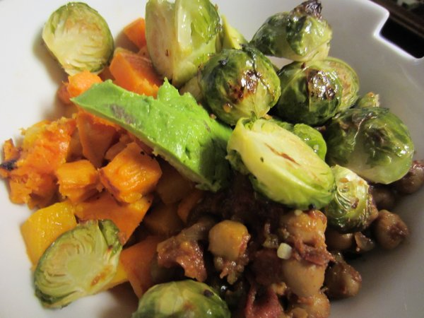 Roasted winter vegetables with salad greens and curried chickpeas.