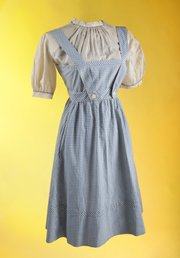 """This undated publicity photo provided by Julien's Auctions shows the original costume worn by Judy Garland in the film """"The Wizard of Oz."""" The dress will be on view at London's Safford Hotel Oct. 9-14, 2012, before being exhibited on Nov. 5 through 9, in Beverly Hills, Calif."""
