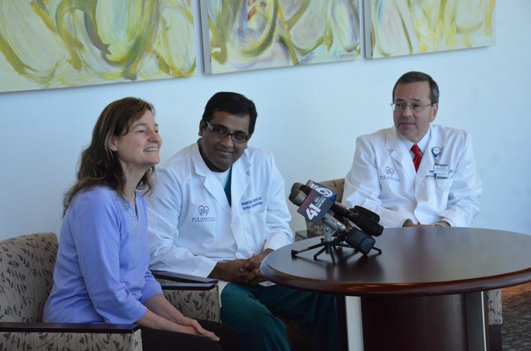 Sarah Howard, of Holt, Mo., left, the first patient to undergo a procedure with the new St. Jude Medical MediGuide technology at Kansas University Hospital, speaks during a news conference Monday, Oct. 8, 2012, at the hospital. Sitting next to her are Dr. Dhanunjaya Lakkireddy, a cardiologist, center, and Dr. Loren Berenbom, director of the Richard and Annette Bloch Heart Rhythm Center. The new technology significantly reduces radiation exposure during many heart procedures.
