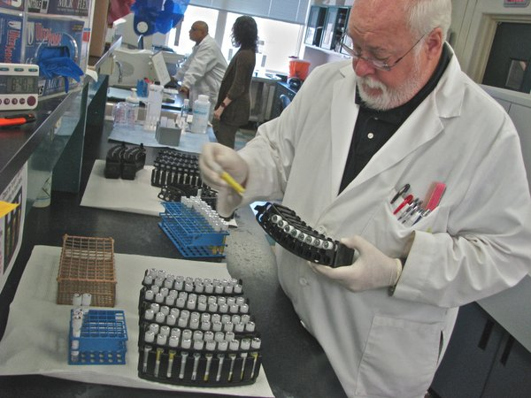 Bob Bumgardner, a microbiologist at the Kansas Department of Health and Environment, tests samples for chlamydia and gonnorhea. The sexually transmitted diseases are the leading causes of infertility in Kansas and the U.S. It is unclear if KDHE will continue testing for the diseases once the Affordable Care Act is implemented. Federal funding for the testing is expected to end once the Medicaid expansions planned under ACA become effective.