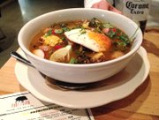 Sopa Port Fonda at Port Fonda, 4141 Pennsylvania Ave., Kansas City, Mo. The spicy soup features pork belly, shredded pork shoulder, bacon-chile broth, fresh vegetables and a fried egg.