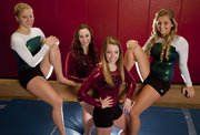 Free State High gymnasts hope to repeat as state champions later this month, while their practice partners from Lawrence High try to build off runner-up finishes in this season's tournaments. Members of the two squads include, from left, Firebirds senior Jacqueline Zaitz, Lions juniors Jessie Abernathy and Cambry Lynch, and FSHS senior Annie Soderberg.