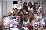 The Kansas freshmen class from top row left are: Zach Peters, Perry Ellis, Jamari Traylor and Ben McLemore. Middle Row: Andrew White, left, and Landen Lucas. Front row sitting: Tyler Self, Rio Adams and Evan Manning.