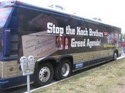 A group called Patriot Majority USA pulled up in its anti-Koch bus at the Statehouse on Friday.