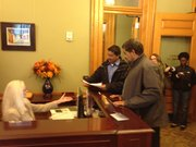 Sid Voorakkara with Patriot Majority USA delivers letter to Gov. Sam Brownback's office. The group urged Brownback to change his policies.
