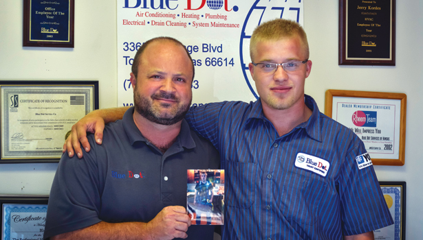 "Von Kopfman, of Topeka, is pictured with his son, Jordan, while holding a picture of Jordan's twin brother, Jacob, who died in August 2011 after being in a work-related accident. To help in their grieving process, they wrote letters to Jacob. It helped and so they encouraged others who had lost loved ones to do the same. Those letters are now being published in book, ""The Letters Project Book: Letters to Loved Ones,"" which is scheduled to be available in December."