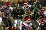 Free State running back Demarko Bobo breaks through the Wyandotte defense during their game Friday, Oct. 12, 2012, at FSHS.