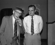 Author William Burroughs and Leonard Magruder stand in the lobby of Liberty Hall during River City Reunion week. Burroughs' personal secretary, James Grauerholz, and poet Allen Ginsberg organized the event.