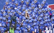 The Kansas football team huddles up prior to its game against Oklahoma State on Oct. 13, 2012, at Memorial Stadium.