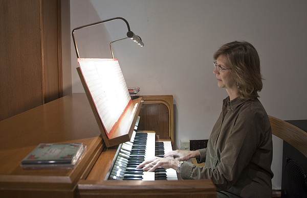 In this 2011 file photo, Tandy Reussner, a Ph.D concert organist, practices for the Organ Vespers concert to benefit local charities.