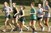 A group of Free State runners pace with Sarah Schaffer, a Firebirds senior runner with Down syndrome, third from left, during the C-Team 4K on Monday, Oct. 15, 2012 at Rim Rock Farm in Lawrence.