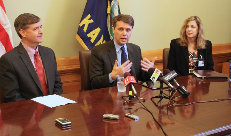 Top welfare officials from the administration of Gov. Sam Brownback during an April press conference about the state's 1115 waiver application. From left: Dr. Robert Moser, secretary of the Kansas Department of Health and Environment; Lt. Gov. Jeff Colyer, also a physician; and Dr. Susan Mosier, state Medicaid director.