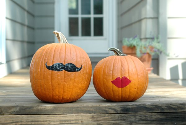 These simple Mr. and Mrs. Pumpkins need only a painted-on mustache and a pair of lips.