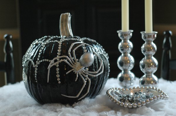 The Black Widow Pumpkin was created with spray paint and glued-on rhinestones.