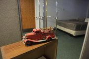 A toy fire truck rests on a bookcase at Lawrence Fire Station No. 1, 746 Kentucky St. Some firefighters say they've seen a dark figure with red eyes in the dorm area.