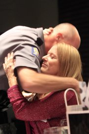 Gay Belcher hugs Lawrence police officer Tracy Russell, whose quick action helped save Belcher's life when she needed CPR. The two attended Tuesday's Valor Public Safety Awards presentation at the Lied Center.
