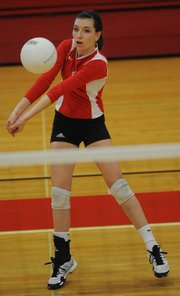 Lawrence High senior Zoe Reed eyes a return during a match against St. James on Tuesday, Oct. 16, 2012, at LHS.