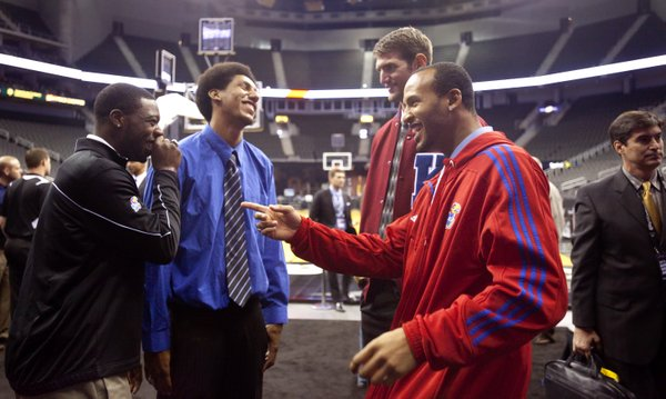 The four Kansas seniors from left, Elijah Johnson, Kevin Young, Jeff Withey and Travis Releford joke around before taking their places at the interview table during Big 12 Media Day on Wednesday, Oct. 17, 2012 at the Sprint Center in Kansas City, Mo. Coaches and players representing each school in the conference were available for interviews.