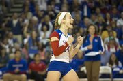 Kansas' Jamie Mathieu celebrates a point during Kansas' volleyball match against Kansas State on Wednesday, Oct. 17, 2012, at  Horejsi Center.