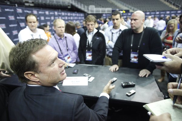 Kansas coach Bill Self talks to reporters at Big 12 media days on Oct. 17, 2012, at Sprint Center in Kansas City, Mo.