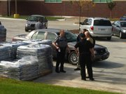 Lawrence police work outside HyVee, 3504 Clinton Parkway, after witnesses reported a man with a shotgun in the area.