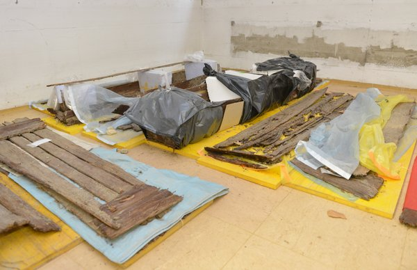 In this picture taken Oct. 8, 2012 remains of coffins are seen in a basement of the hospital in Hall near Innsbruck, Austria. The Nazi-era psychiatric patients were demeaned, starved, brutalized, and left to die. More than half, say those involved, suffered from broken ribs and other bone fractures from blows likely dealt by hospital personnel.