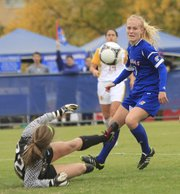 Kansas University's Sarah Robbins (3) tries getting past Iowa State goalkeeper Lindsay Frank (2) during a match on Friday, Oct. 19, 2012, at Jayhawk Soccer Complex.