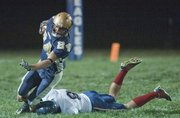 Veritas Christian's Andrew Harvey, left, tries to elude St. Mary's defender Brian Rebegila during their game Friday, Oct. 19, 2012, at the Eagles Nest.