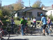 Abby Pierron, left, shows a bike tour group a location in East Lawrence where the poet Langston Hughes once lived. Pierron, education and programs coordinator for the Watkins Museum of Community History, led the group on a tour of several East Lawrence landmarks Saturday.