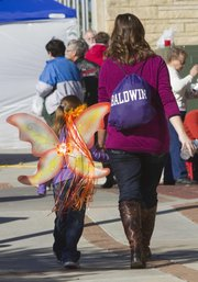 A mother and daughter walk together at the 55th Annual Baldwin Maple Leaf Festival on Saturday Oct 20, 2102.