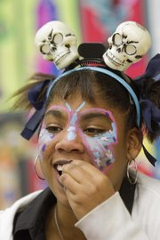 Jerreica Smith, 11, enjoyed some sweet treats during Family Fun Fall Festival at Woodlawn School.
