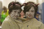 Twins Alice, left, and Zella Lubbin-Meyer, 9, dressed as a two-headed monster during Woodlawn School's Family Fun Fall Festival. Parents and children took part in dressing in Halloween costumes, pumpkin rolling, face painting and other festivities. The school has put on the festival the past three years instead of having Halloween classroom activities.