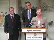 Speaking Monday at Highland Park Central Elementary is Karen Godfrey, president of the Kansas-National Education Association. Behind her from left are Senate Minority Leader Anthony Hensley, D-Topeka, and House Minority Leader Paul Davis, D-Lawrence. The three unveiled a website for Kansans to take a survey on how school finance cuts have affected schools.