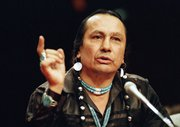 Russell Means, who headed the American Indian Movement, (AIM) testifies before a special investigative committee of the Senate Select Committee on Capitol Hill, in Washington in a Jan. 31, 1989 file photo. Means, a former American Indian Movement activist who helped lead the 1973 uprising at Wounded Knee, reveled in stirring up attention and appeared in several Hollywood films, died early Monday, Oct. 22, 2012, at his ranch Zzxin Porcupine, S.D., Oglala Sioux Tribe spokeswoman Donna Solomon said. He was 72.