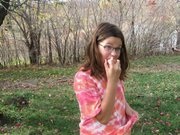 Cordley Elementary School student Zoe Diaz Moore eats a just-picked apple Sunday, Oct. 21, during a parent-led field trip to Fieldstone Orchard in Overbrook.