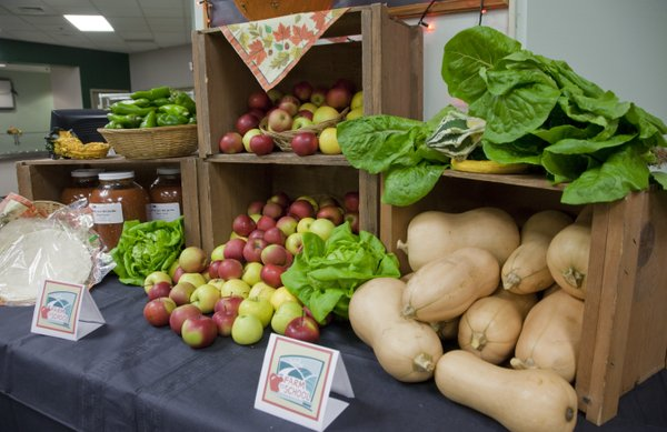 A display of local fruits and vegetables in the Free State High School cafeteria includes items that will be served in a lunch featuring locally sourced food. Thursday's districtwide lunch is the highlight of Lawrence's Farm to School Week observance.