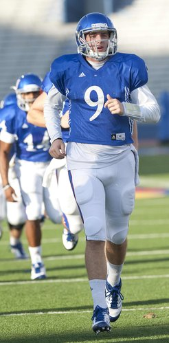Kansas University quarterback Jake Heaps (9) warms up during practice on Tuesday, Oct. 23, 2012, at Memorial Stadium.